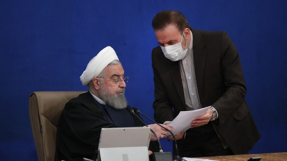 A handout picture provided by the Iranian presidency on January 27, 2021 shows President Hassan Rouhani (L) talking with presidential chief of staff Mahmoud Vaezi during a cabinet session in the capital Tehran. (AFP)