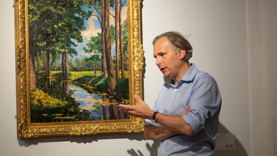 Jean Paul Engelen, Deputy Chairman and worldwide co-head of 20th century and contemporary art at Phillips Auction House speaks next to The Moat, Breccles painting made by Winston Churchill and owned by the Onassis family, in New York. (AFP)