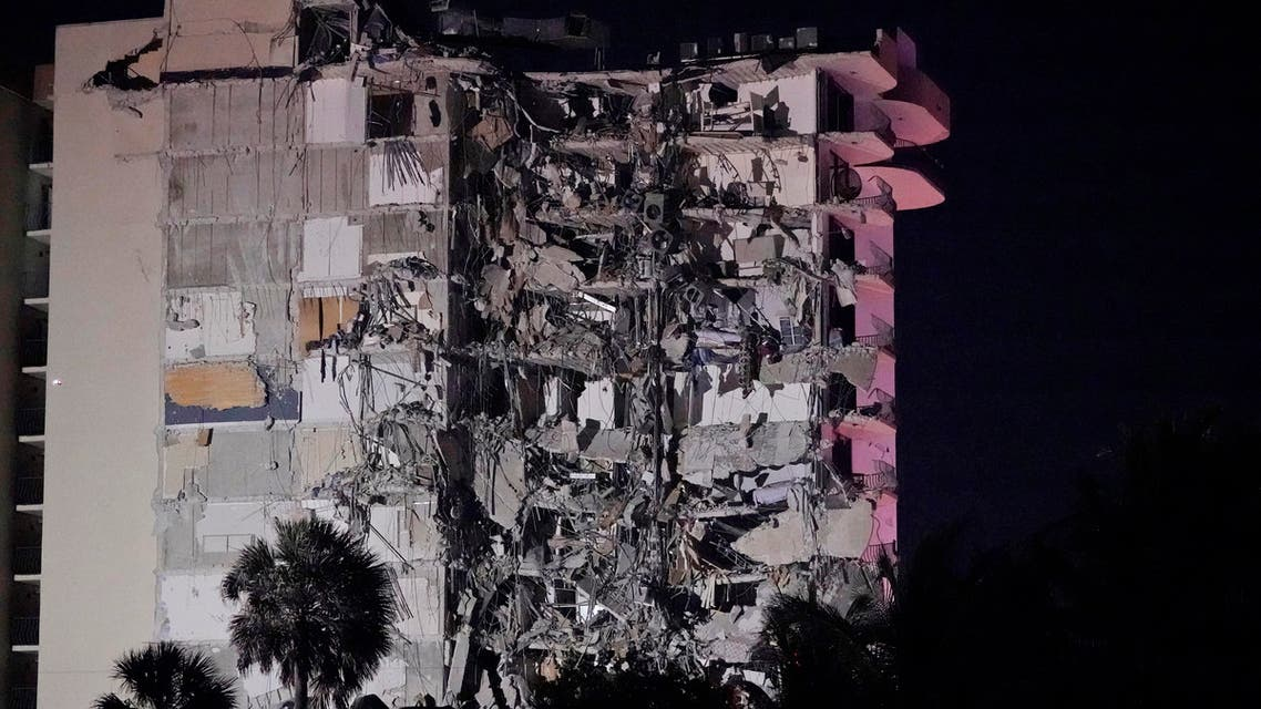 A partially collapsed building is seen early Thursday, June 24, 2021, in the Surfside area of Miami, Florida. (AP)