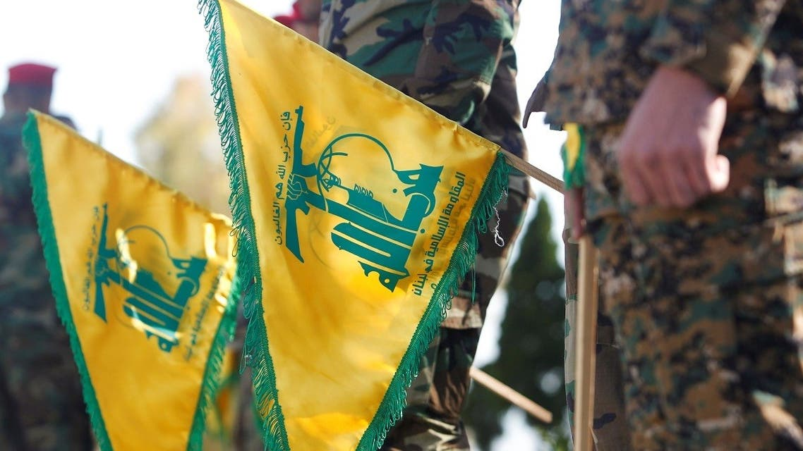 Hezbollah members hold flags marking Resistance and Liberation Day, in Kfar Kila near the border with Israel. (File Photo: Reuters)