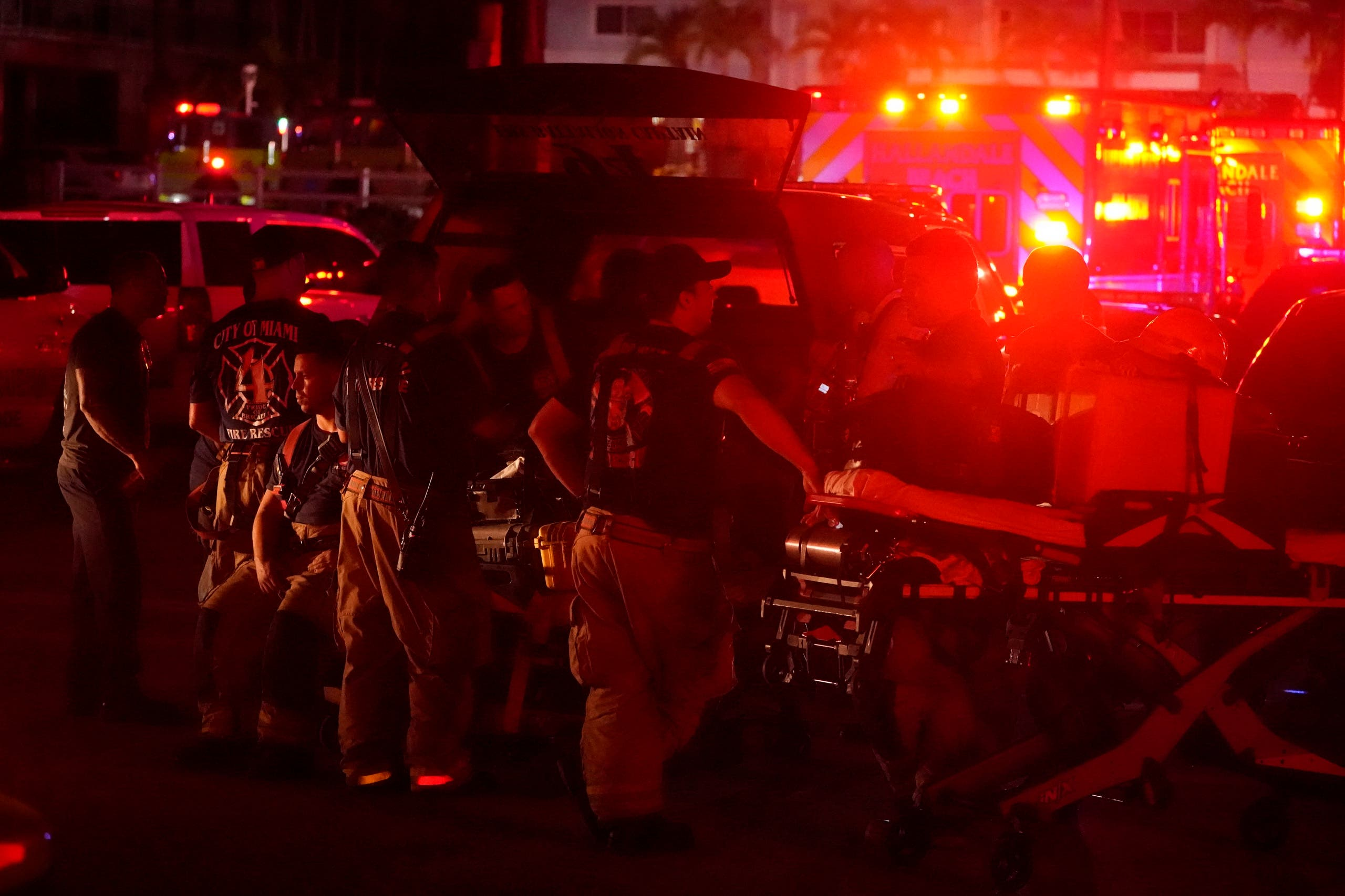 Firefighters standby after a partial collapse of a building, Thursday, June 24, 2021, in the Surfside area of Miami, Florida. (AP)