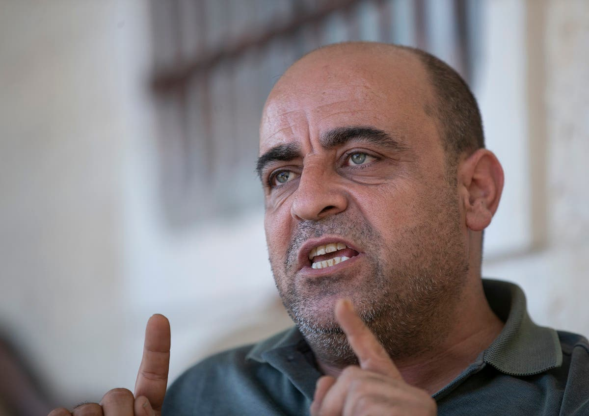 Nizar Banat, an outspoken of the Palestinian Authority, speaks to journalists at the family house, in the West Bank city of Hebron, May 4, 2021. (AP)