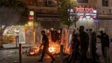 Palestinians protest against President Abbas after activist Banat's death