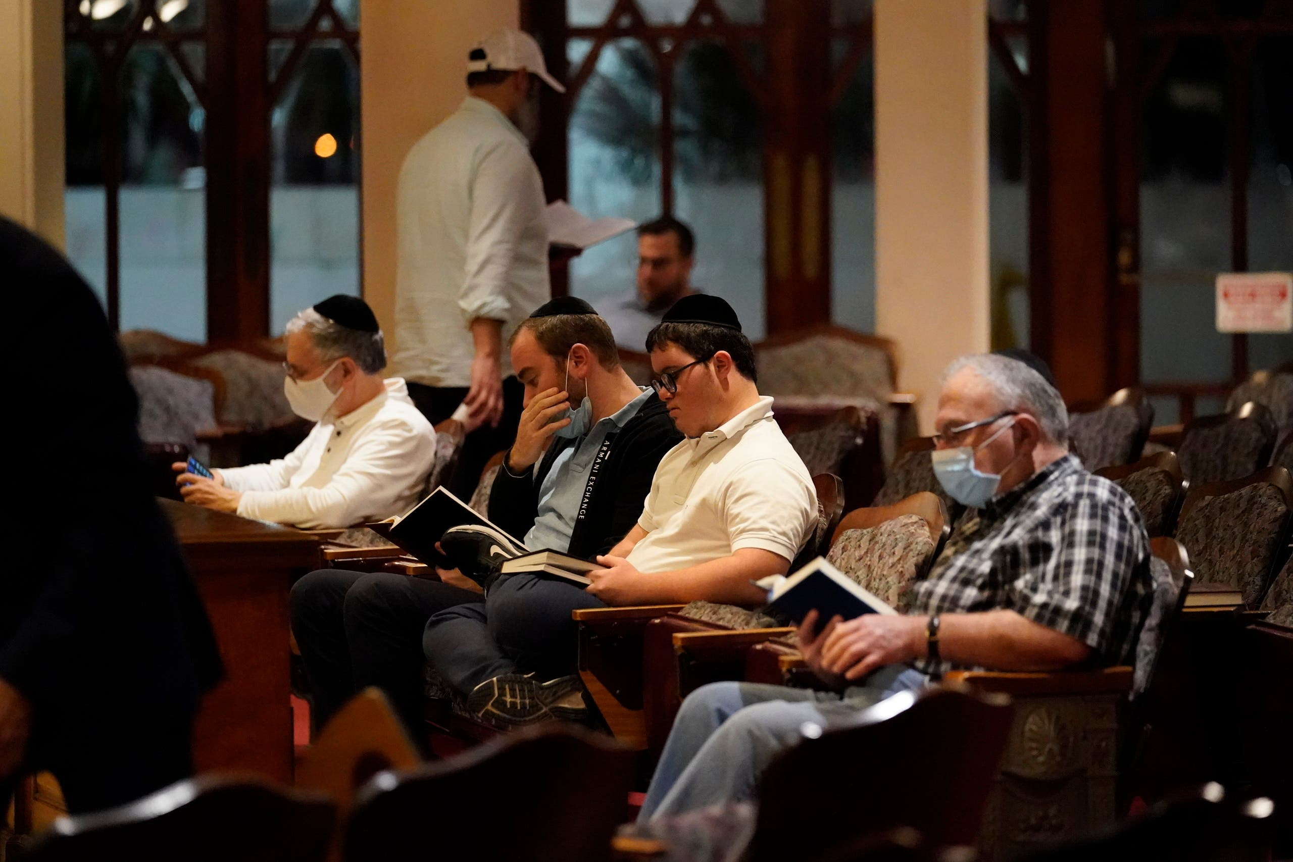 Jewish faithful pray at the Shul of Bal Harbour after members of the community were reported missing in the partial collapse of a 12-story beachfront condo, Thursday, June 24, 2021, in the Surfside area of Miami. (AP)