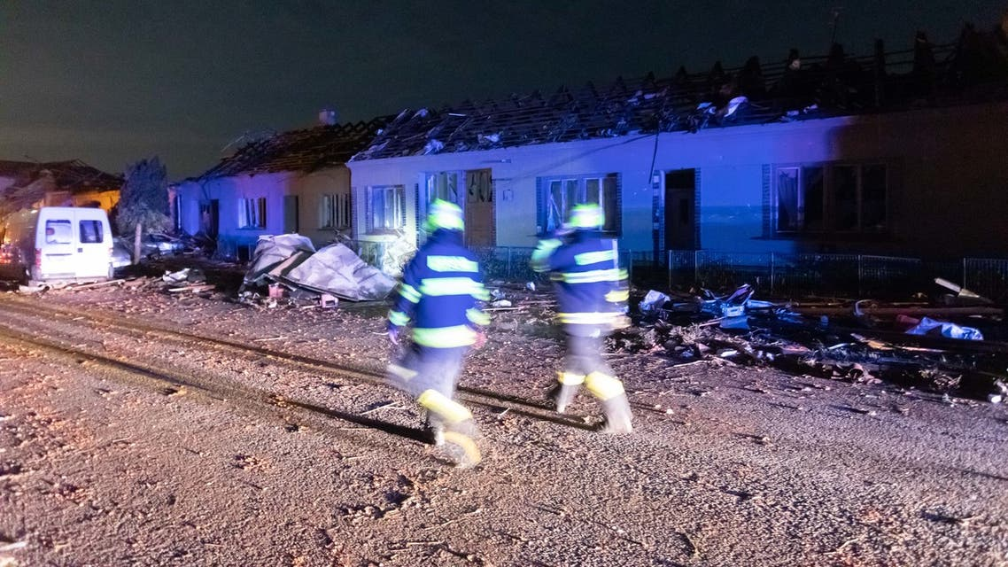 Emergency responders walk past damaged buildings in the village of Hrusky, 60 km south of Brno, South Moravia, Czech Republic, on June 24, 2021, after it was hit by a tornado. A tornado razed houses to the ground in several places in the southeast of the Czech Republic on June 24, 2021, leaving dozens of injured people, rescuers and politicians said. (File photo: AFP)