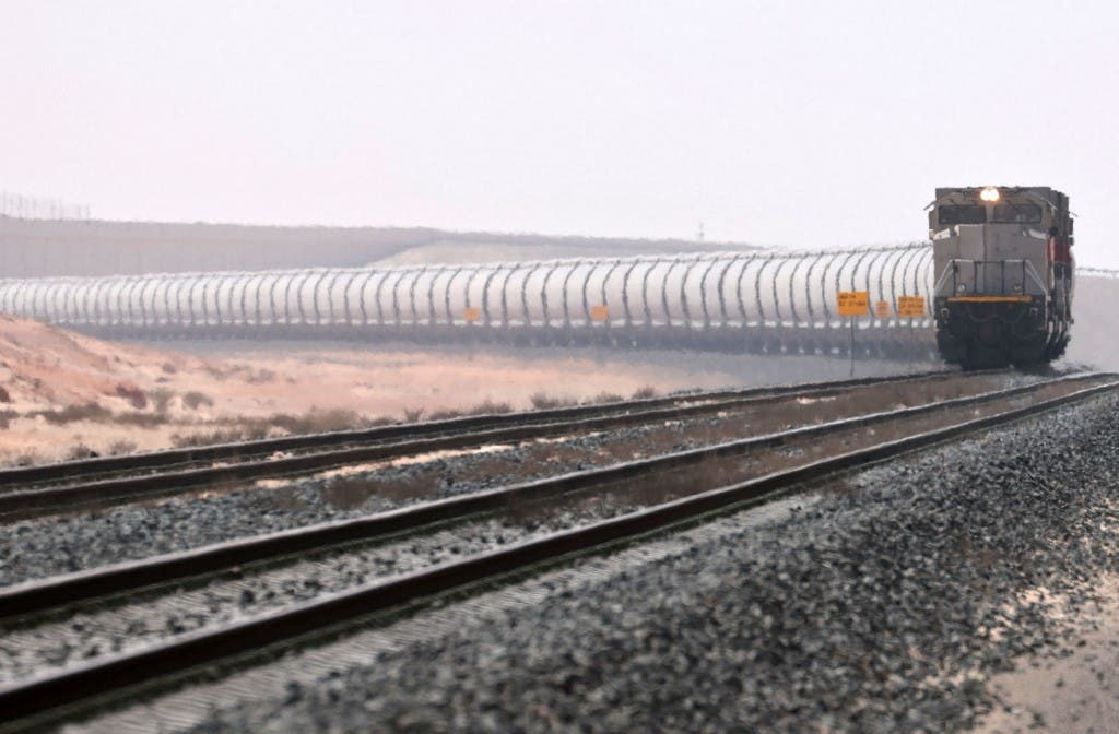 A picture taken on April 1, 2021 shows a train of the Etihad Rail network, in al-Mirfa, in the United Arab Emirates. The United Arab Emirates is well known for its audacious infrastructure and technology projects. (AFP)