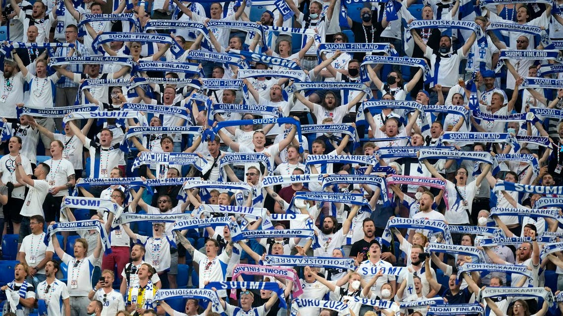 Fans of Finland cheer for their national team during the Euro 2020 soccer championship group B match between Finland and Belgium at Saint Petersburg stadium, in St. Petersburg, Russia, Monday, June 21, 2021. (AP)