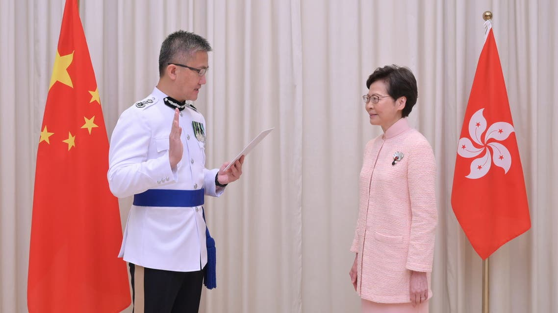 New Commissioner of Police Raymond Siu Chak-yee takes the oath of office witnessed by Chief Executive Carrie Lam in Hong Kong, China June 25, 2021. (Reuters)