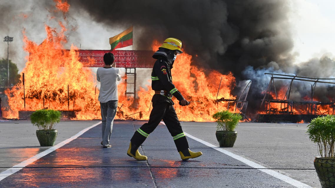 A firefighter walks past a burning pile of seized illegal drugs during a destruction ceremony to mark the United Nations' 'International Day against Drug Abuse and Illicit Trafficking' in Yangon on June 26, 2021.(AFP)