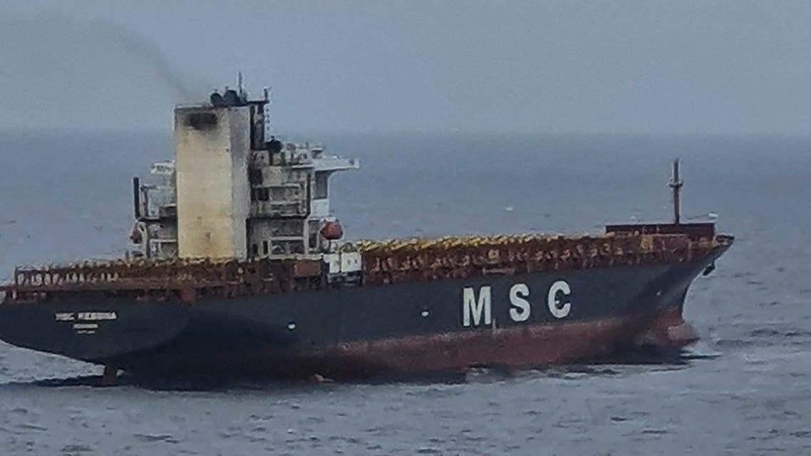 This handout photograph taken on June 25, 2021 and released by the Indian Coast Guard shows smoke billowing from the MSC Messina ship in the Indian Andaman and Nicobar Islands. (Indian Coast Guard/AFP)