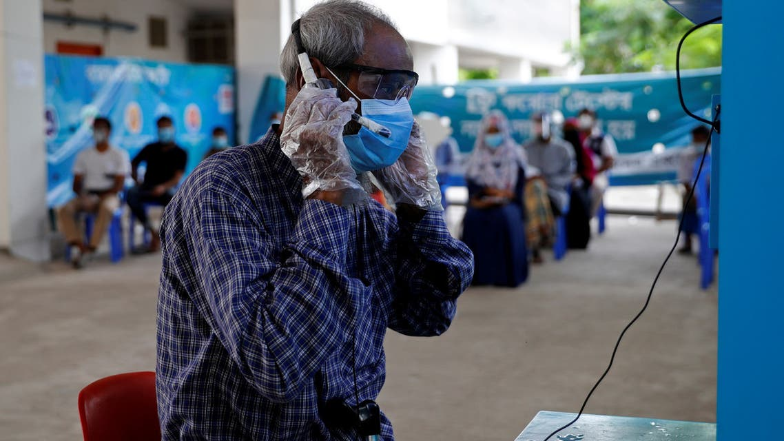 A man wearing a protective mask consults a doctor over video call as he comes for a coronavirus test in the Mugda Medical College and Hospital as the coronavirus disease (COVID-19) outbreak continues in Dhaka, Bangladesh, July 2, 2020. (Reuters)