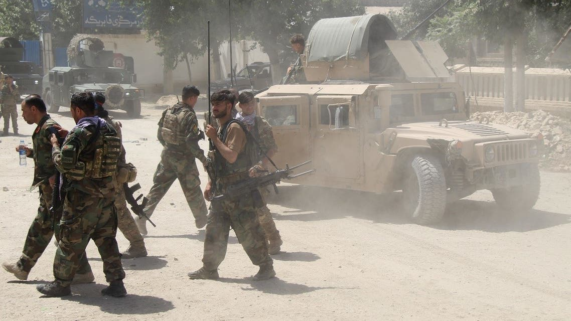 Afghan Commando forces are seen at the site of a battle field where they clash with the Taliban insurgent in Kunduz province, Afghanistan June 22, 2021. (Reuters/Stringer)