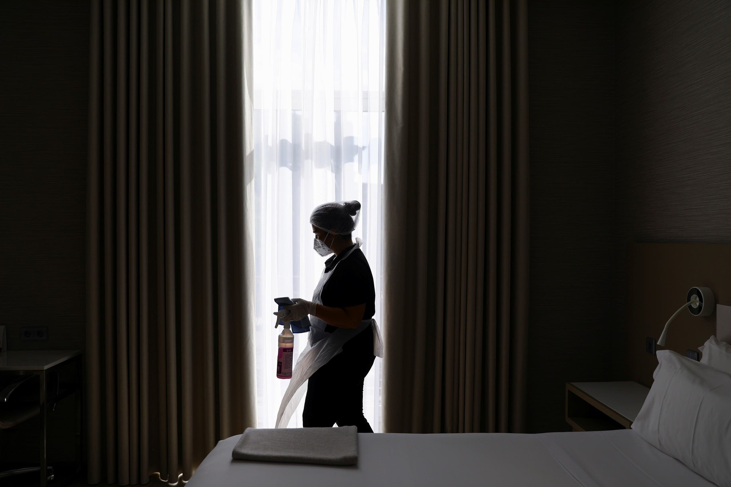 Cleaning staff is seen at a room at the NH Collection Hotel as thousands of English fans make their way to Portugal's northern city of Porto for the Champions League's final match and hotels and bars hope for a boost after the tourism sector was ravaged by the coronavirus disease (COVID-19) pandemic, in Porto, Portugal May 26, 2021. (Reuters)