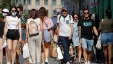 Spain scraps outdoor mask-wearing rule, but many stay covered up