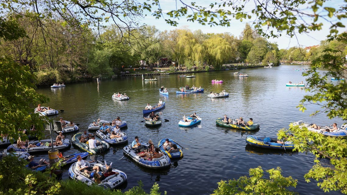 People ride on boats as they enjoy the sunny weather on the Landwehrkanal, as the spread of the coronavirus disease (COVID-19) continues, in Berlin, Germany, May 9, 2021. REUTERS/Christian Mang