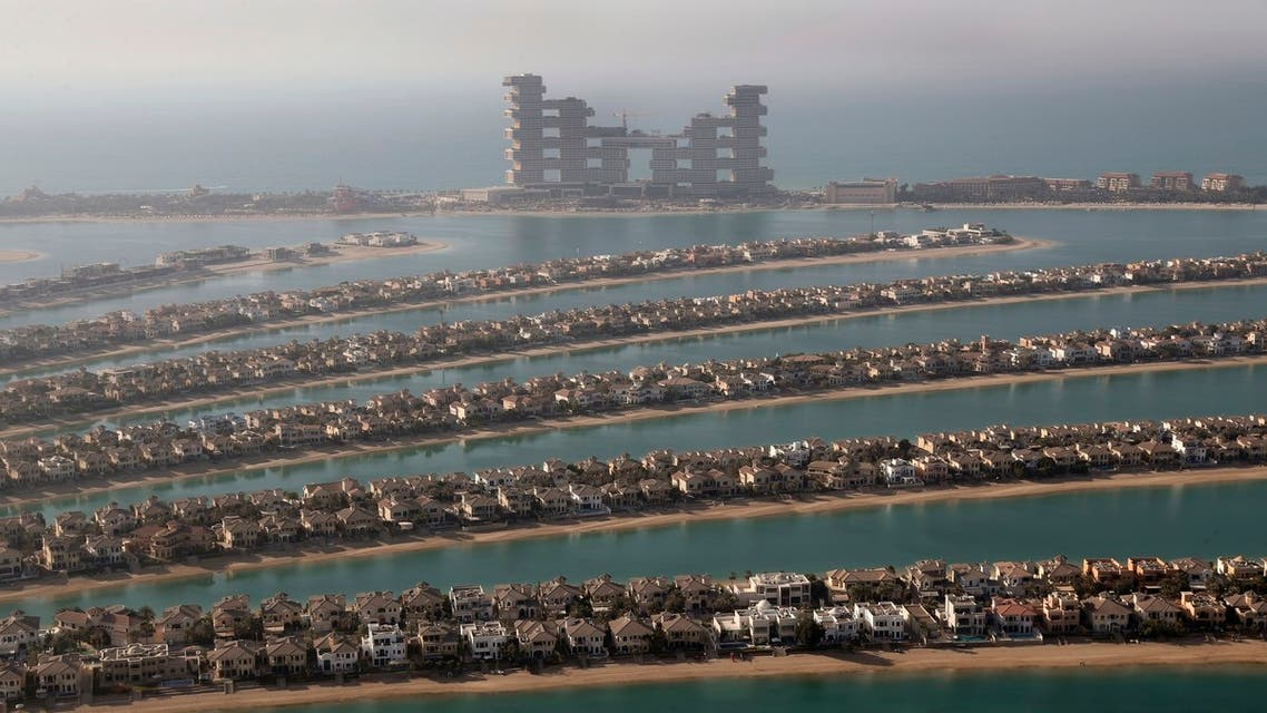 Villas on the fronds of the Jumeirah Palm Island are seen from the observation deck of The View at The Palm Jumeirah, in Dubai, United Arab Emirates, Tuesday, April 6, 2021. (AP)