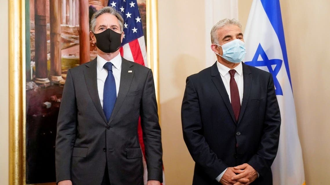 US Secretary of State Antony Blinken and Israeli Foreign Minister Yair Lapid pose for a picture during their meeting in Rome, Italy, June 27, 2021. (Reuters)