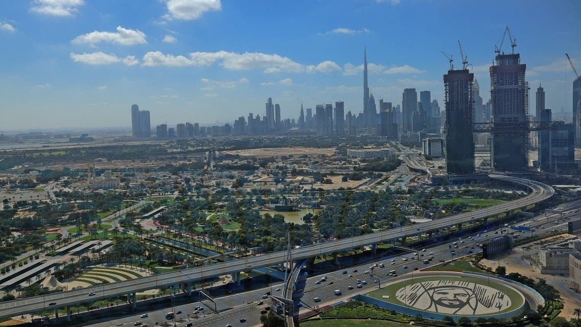 This picture taken on on February 1, 2021 shows a view of the downtown Dubai skyline, with Burj Khalifa, as seen from the Dubai Frame vantage point. (AFP)