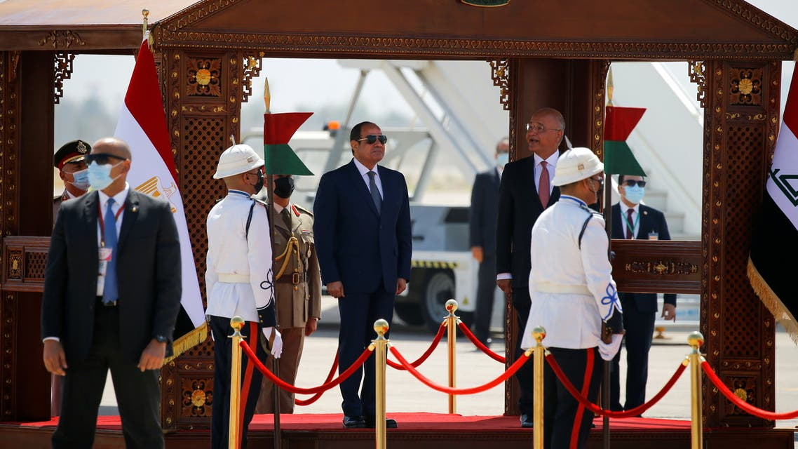 Iraqi President Barham Salih welcomes Egyptian President Abdel Fattah Al-Sisi at Baghdad International Airport in Baghdad, Iraq June 27, 2021. (Reuters)