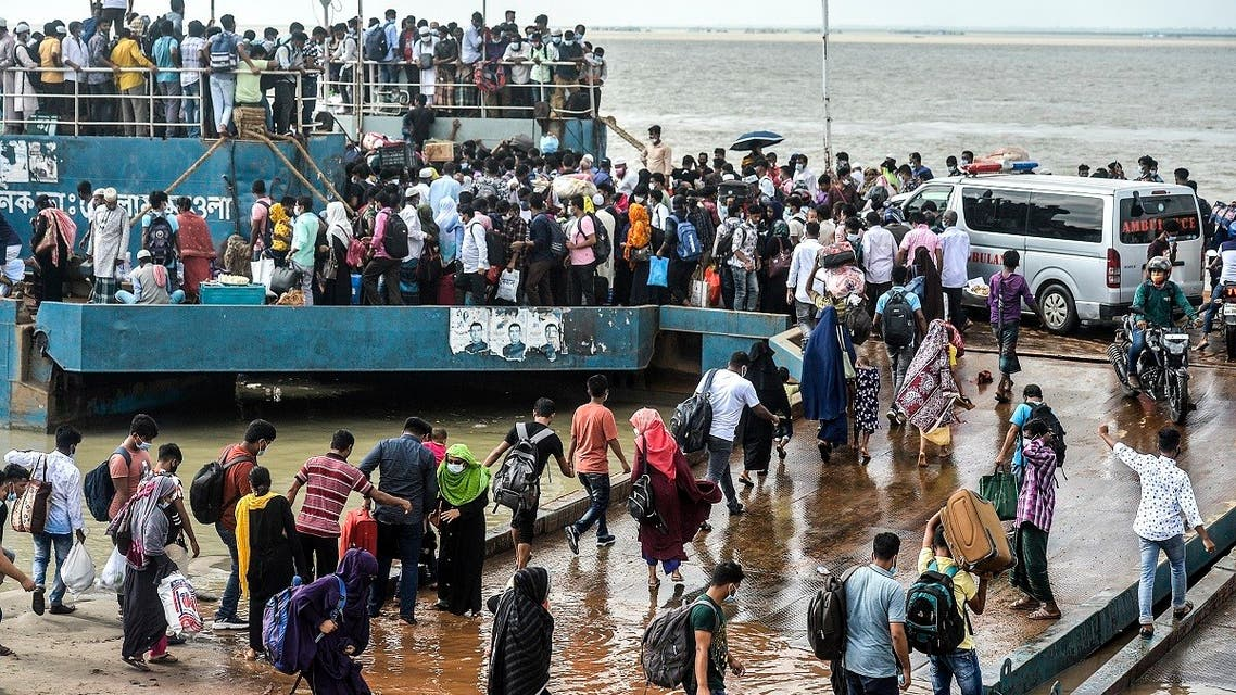 People crowd to board a ferry as authorities ordered a new lockdown to contain the spread of the Covid-19 coronavirus, in Munshiganj on June 27, 2021. (Munir Uz zaman/AFP)