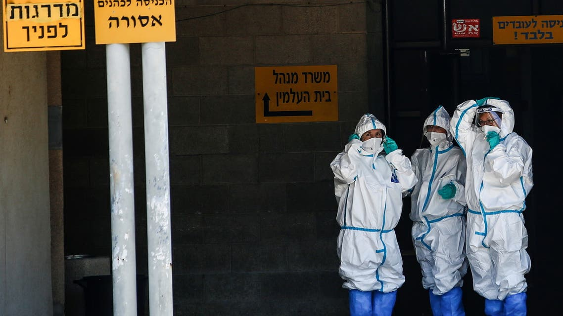 Health workers wear protective suits to protect themselves against COVID-19, near Tel Aviv, Israel April 28, 2021. (Reuters)