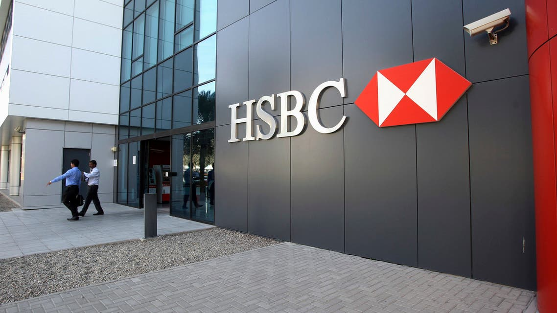 People exit an HSBC branch at Dubai Internet City in Dubai January 4, 2012. (Reuters)