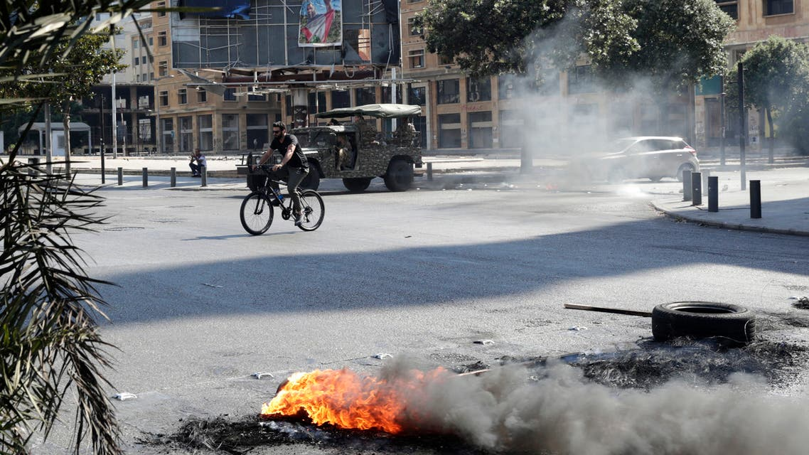 Demonstrators burn tires to block a main road in the centre of Lebanon's capital Beirut on June 26, 2021, as they protest against dire living conditions amidst the ongoing economical and political crisis. (AFP)