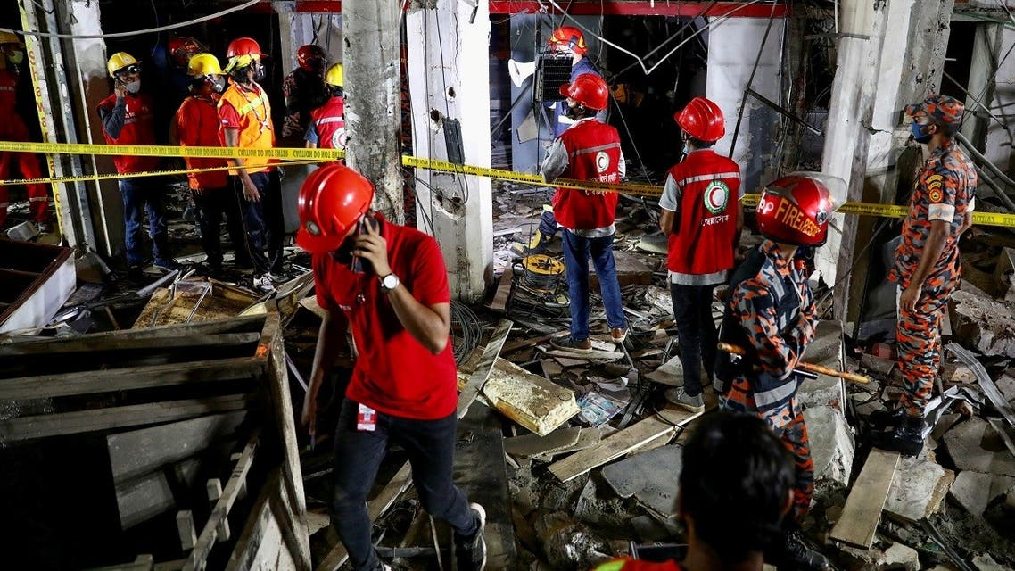 Rescue workers work at the site after a blast in a shop that killed several people in Dhaka, Bangladesh, June 27, 2021. (Reuters/Mohammad Ponir Hossain)