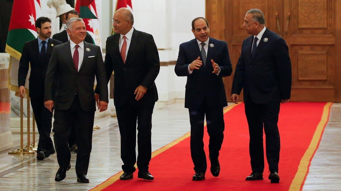 Iraqi President Barham Salih and Prime Minister Mustafa al-Kadhimi meet with King Abdullah II of Jordan and Egypt's President Abdel Fattah al-Sisi, in Baghdad, Iraq, June 27, 2021. REUTERS/Khalid al-Mousily