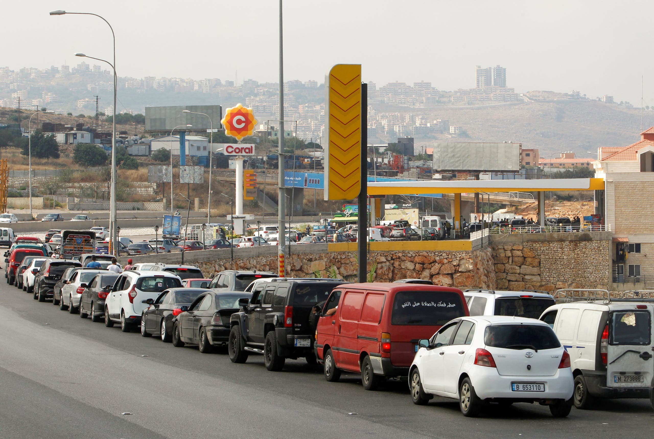Cars stand in line at a gas station as they wait to fuel up in Damour, Lebanon June 25, 2021. (Reuters)