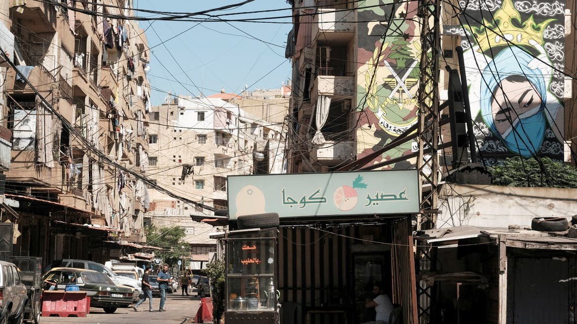 People walk along a street in Tripoli, Lebanon June 21, 2021. Picture taken June 21, 2021. (Reuters)