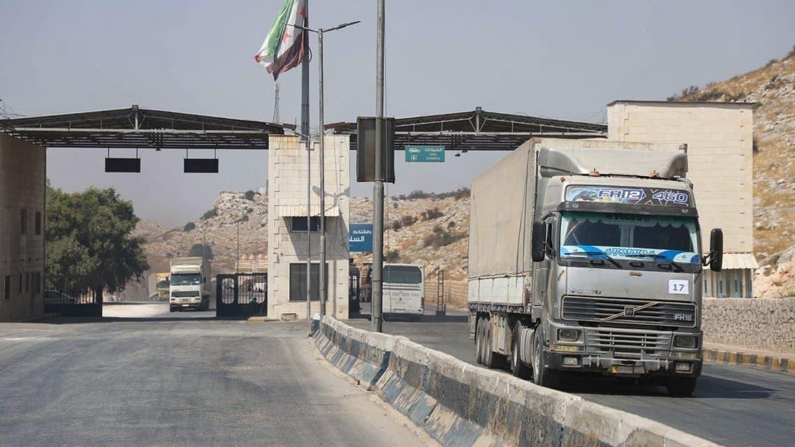 International humanitarian aid trucks cross into Syria's northwestern Idlib province through the Bab al-Hawa border crossing with Turkey, on September 7, 2020. (Aaref Watad/AFP)