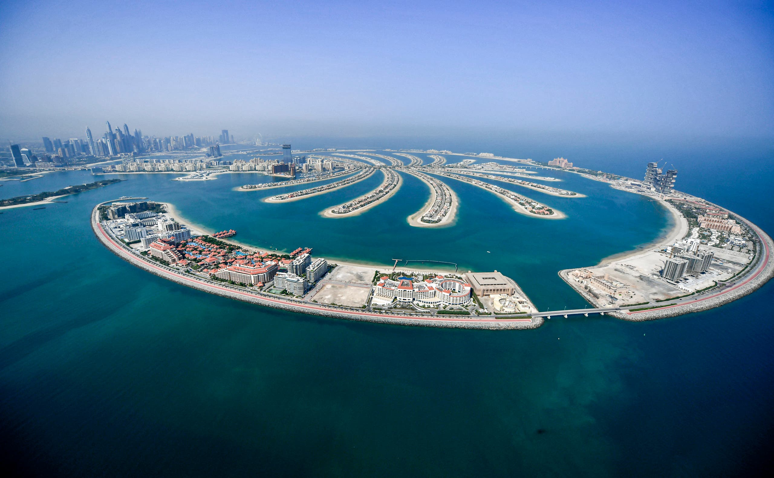 This picture taken on July 8, 2020 shows an aerial view of the man-made Palm Jumeirah archipelago off the Gulf emirate of Dubai, during a government-organized helicopter tour. (AFP)