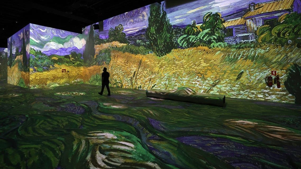 Visitors look at projected paintings and drawings at the Van Gogh exhibit produced by Culturespaces and directed by Gianfranco Iannuzzi, Renato Gatto, and Massimiliano Siccardi, during a preview of the digital exhibition titled Infinity des Lumieres in Dubai, in the United Arab Emirates, on June 28 , 2021. (AFP)