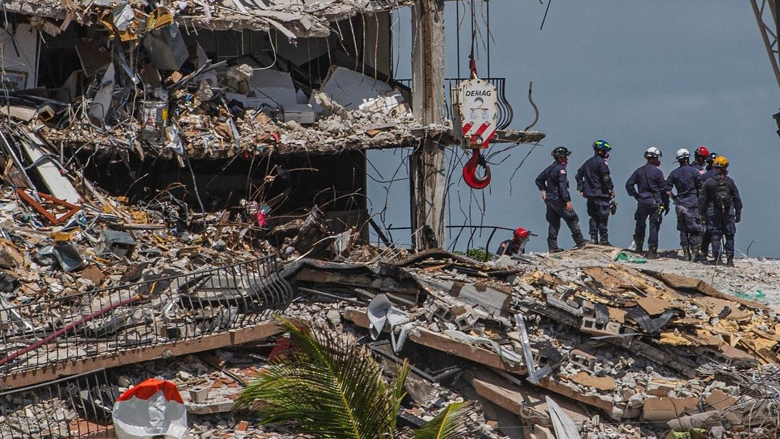 Search and Rescue teams look for possible survivors in the partially collapsed 12-story Champlain Towers South condo building on June 27, 2021 in Surfside, Florida. (AFP)