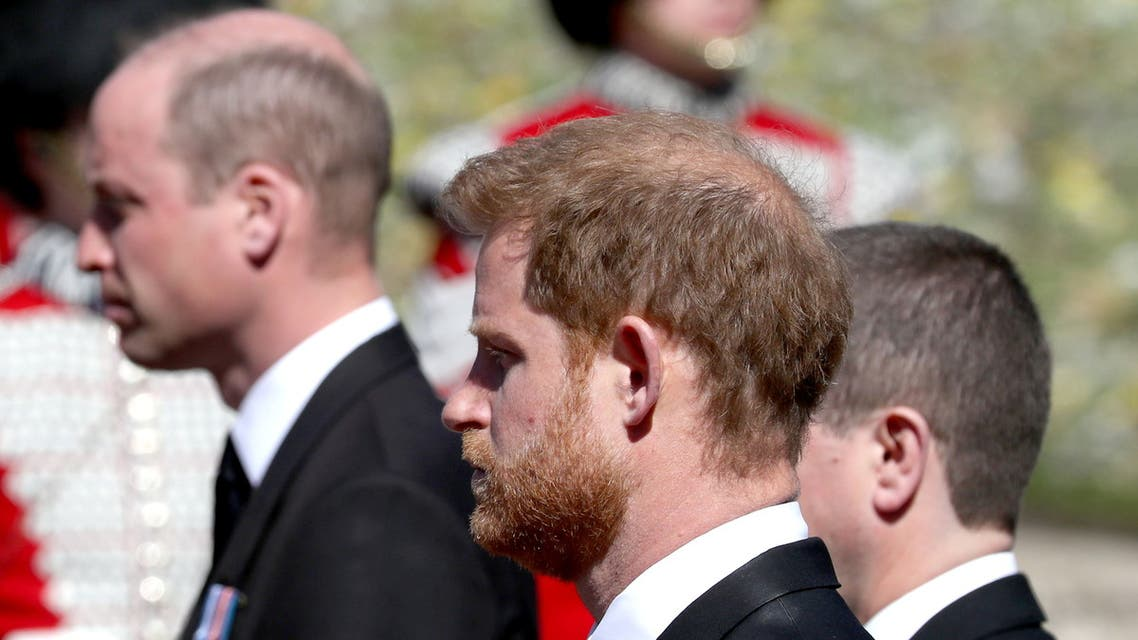 Britain's Prince William and Britain's Prince Harry follow the coffin of Britain's Prince Philip, as it passes through the Parade Ground, during his funeral at Windsor Castle, Britain, April 17, 2021. (Reuters)