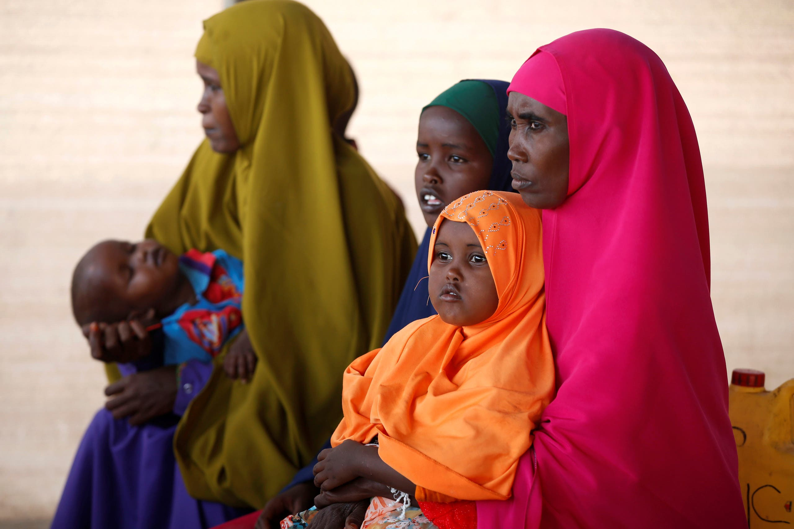 Somali refugees waits to board a UN plane bound for Somalia, part of the UN's Voluntary Repatriation programme, in the Dadaab refugee camp, Kenya December 19, 2017. REUTERS/Baz Ratner