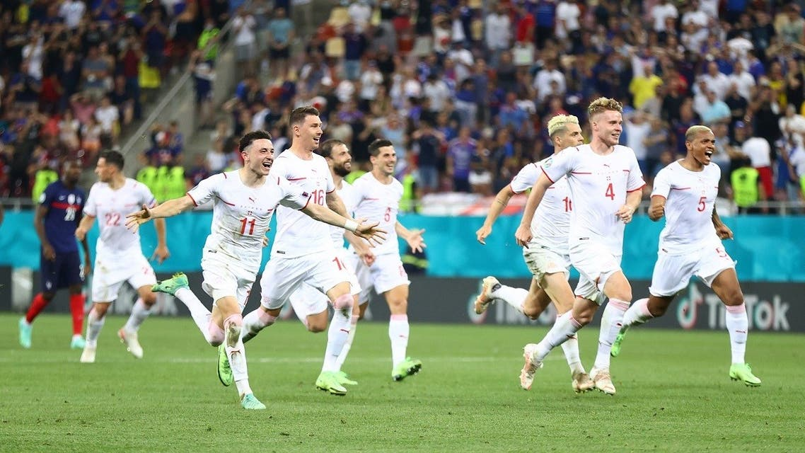 Switzerland players celebrate after winning the penalty shoot-out. (Pool via Reuters)