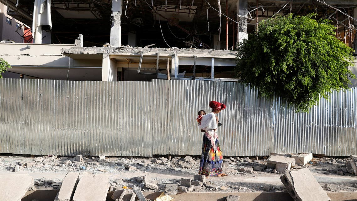 A woman walks past the rubble of a building damaged by fighting in the town of Shire, Tigray region, Ethiopia, March 17, 2021. Picture taken March 17, 2021. (Reuters)