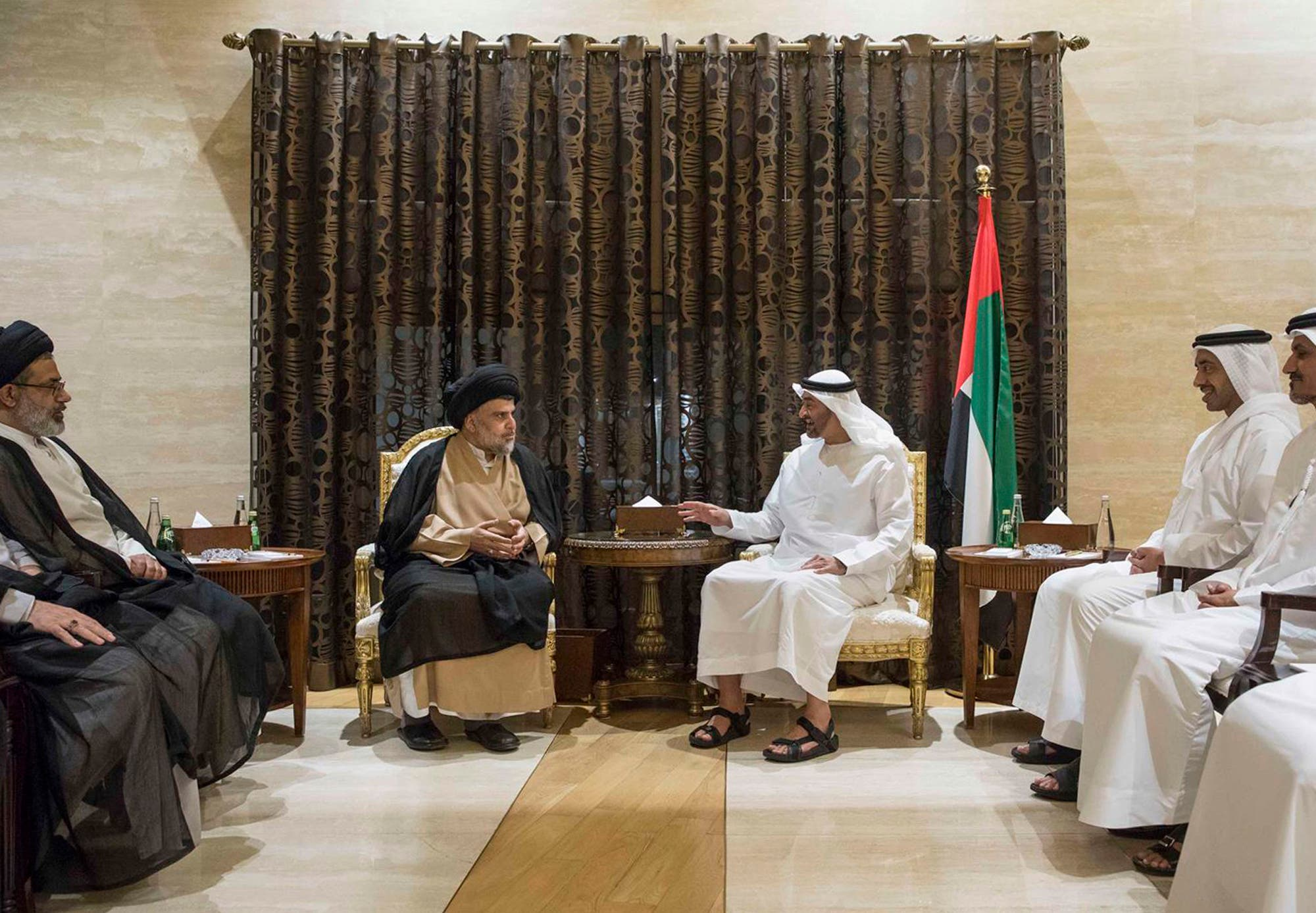 In this Sunday, August 13, 2017 photo released by Emirates News Agency, Mohamed bin Zayed Al Nahyan, Crown Prince of Abu Dhabi and Deputy Supreme Commander of the UAE Armed Forces, center right, and other officials, meet with influential Iraqi Shia cleric, Muqtada Al-Sadr, in Abu Dhabi, United Arab Emirates. (AP)