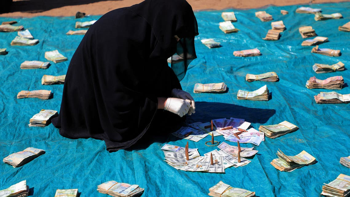 Huthi female supporters collect money to support Huthi militias fighting Saudi-backed Yemeni government forces in the port city of Hodeidah, during a rally in the capital Sanaa on November 10, 2018.