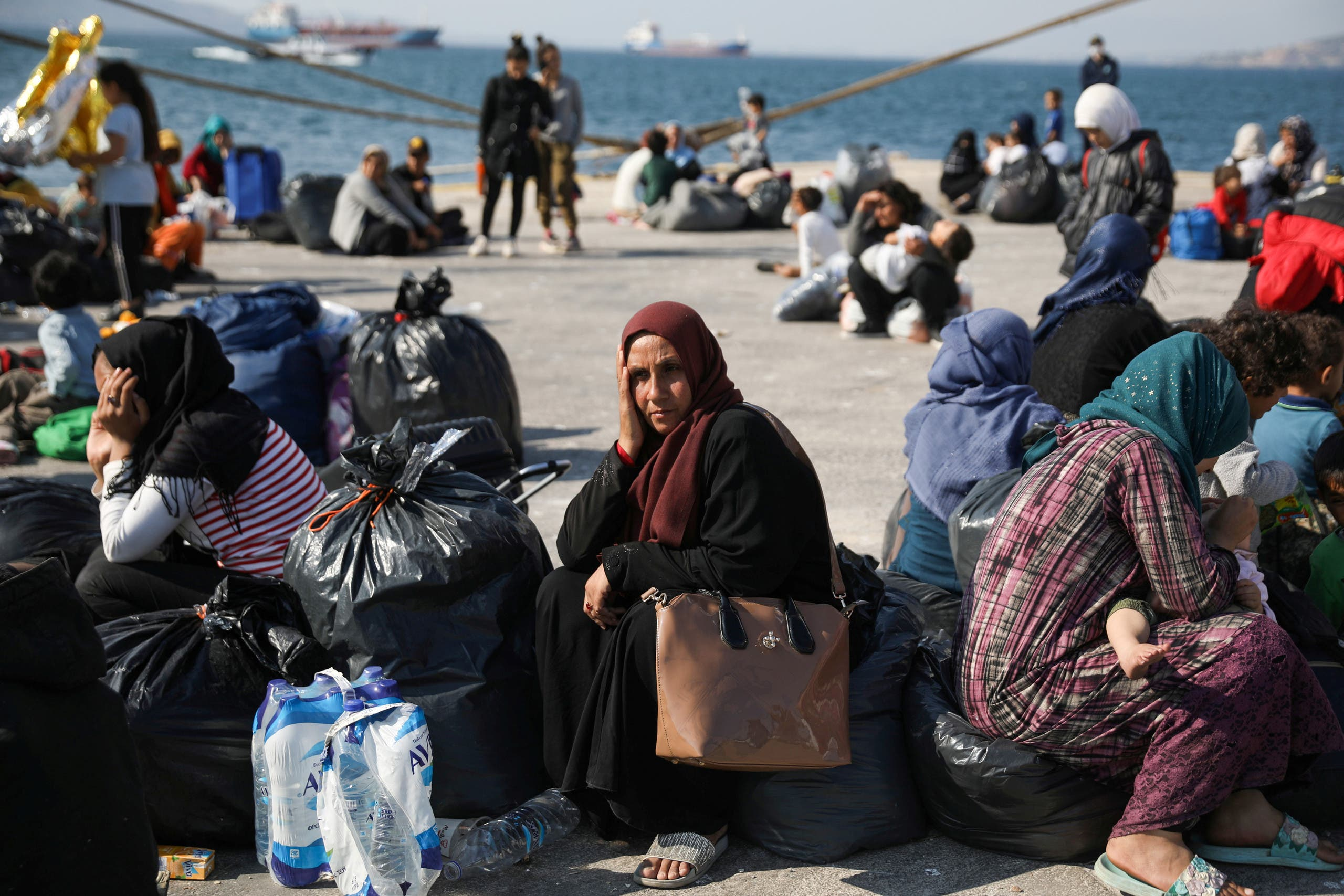 Refugees and migrants wait to be transferred to camps on the mainland, at the port of Elefsina near Athens Greece, October 22, 2019. (Reuters)
