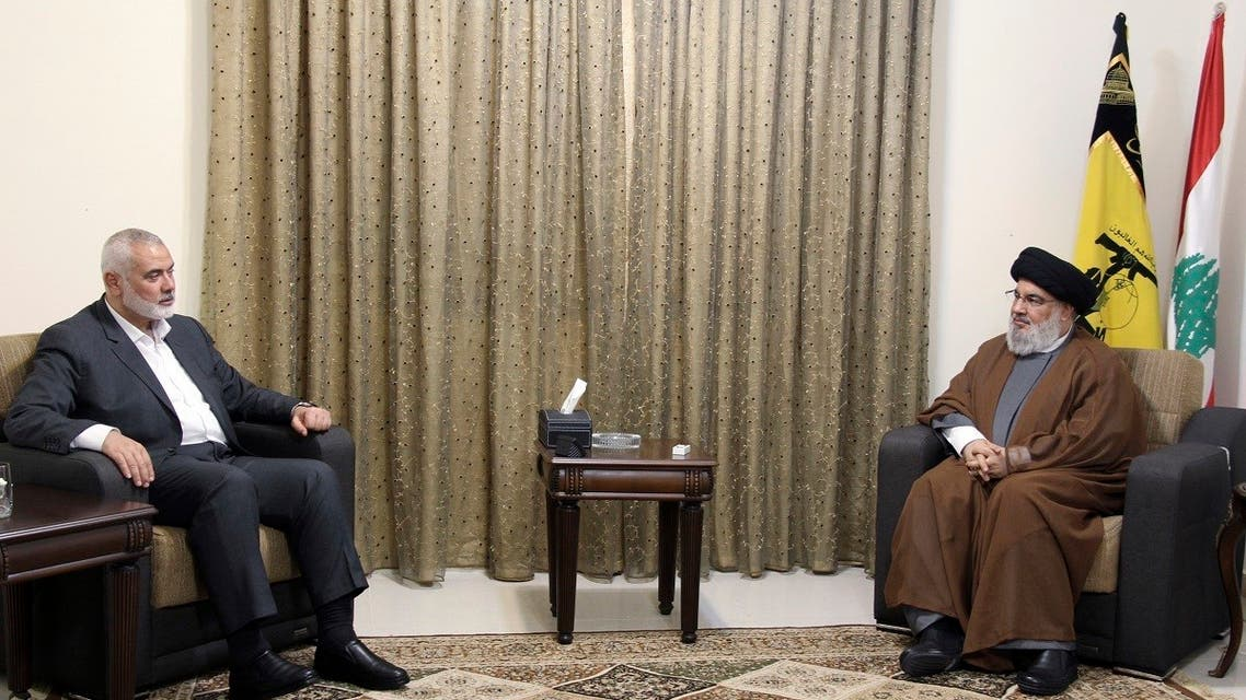 This picture released by the Hezbollah Media Relations Office, shows Hezbollah leader Hassan Nasrallah, right, meeting with Ismail Haniyeh in Beirut, Lebanon, June 29, 2021. (AP)
