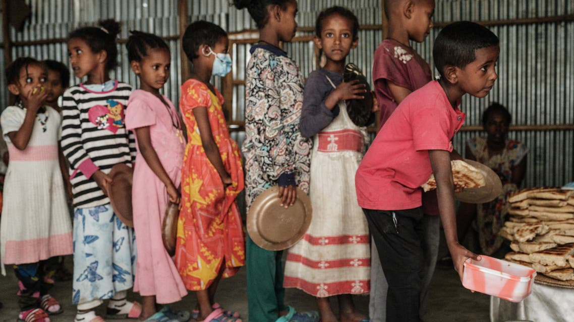 Children, who fled the violence in Ethiopia's, Tigray region, wait in line for breakfast organized by a self-volunteer Mahlet Tadesse, 27, in Mekele, the capital of Tigray region, on June 23, 2021. Mahlet Tadesse, a former business woman now studying masters in sociology at Mekelle University, supports about 100 women with 155 kids at Midregenet Elderly Center. She negotiated with the city to transform the public building into an IDP camp to host pregnant or lactating mothers from other IDP camps in inferior conditions two months ago.