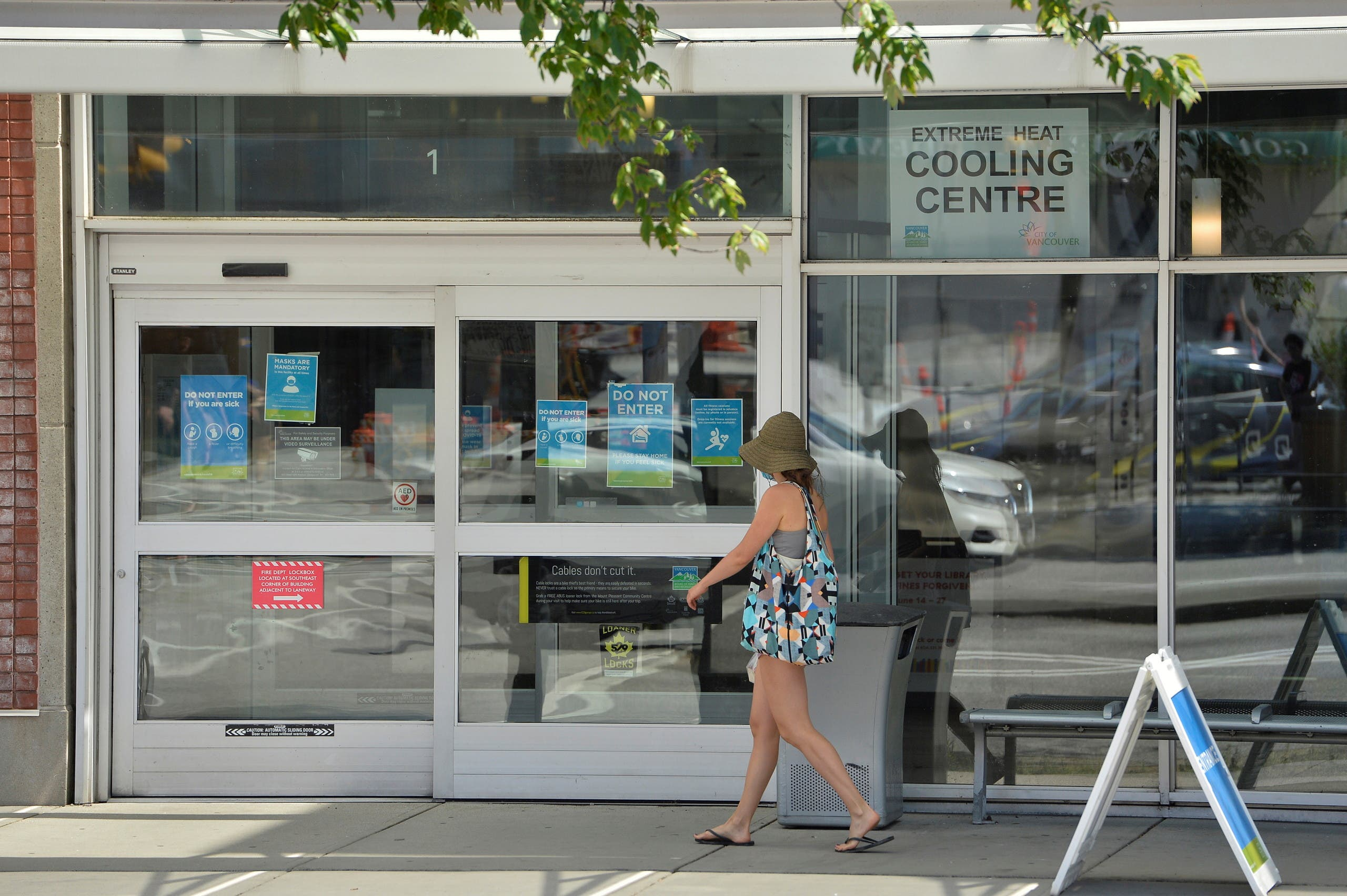 A woman enters a cooling centre during the scorching weather of a heatwave in Vancouver, British Columbia, Canada June 27, 2021.  (Reuters)