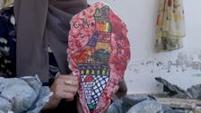 Gaza artist paints on the remains of her demolished house