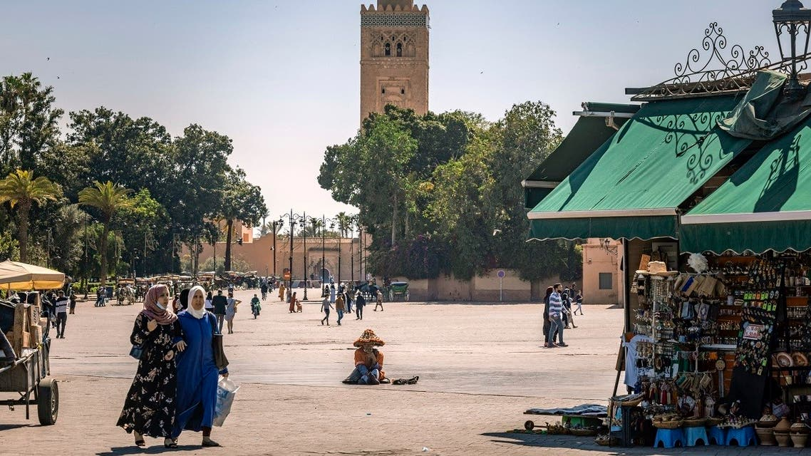 Few people walk in the Jemaa el-Fna square in the Moroccan city of Marrakesh, on May 6, 2021, which has been impacted by the COVID-19 crisis since its start due to the scarcity of tourism. (Fadel Senna/AFP)