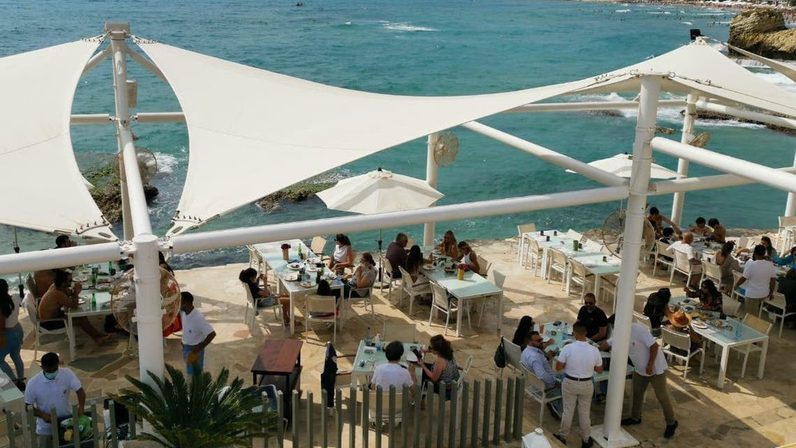 People having lunch by the sea in the coastal city of Byblos on June 12, 2021. (Image: Vanessa Ghanem)