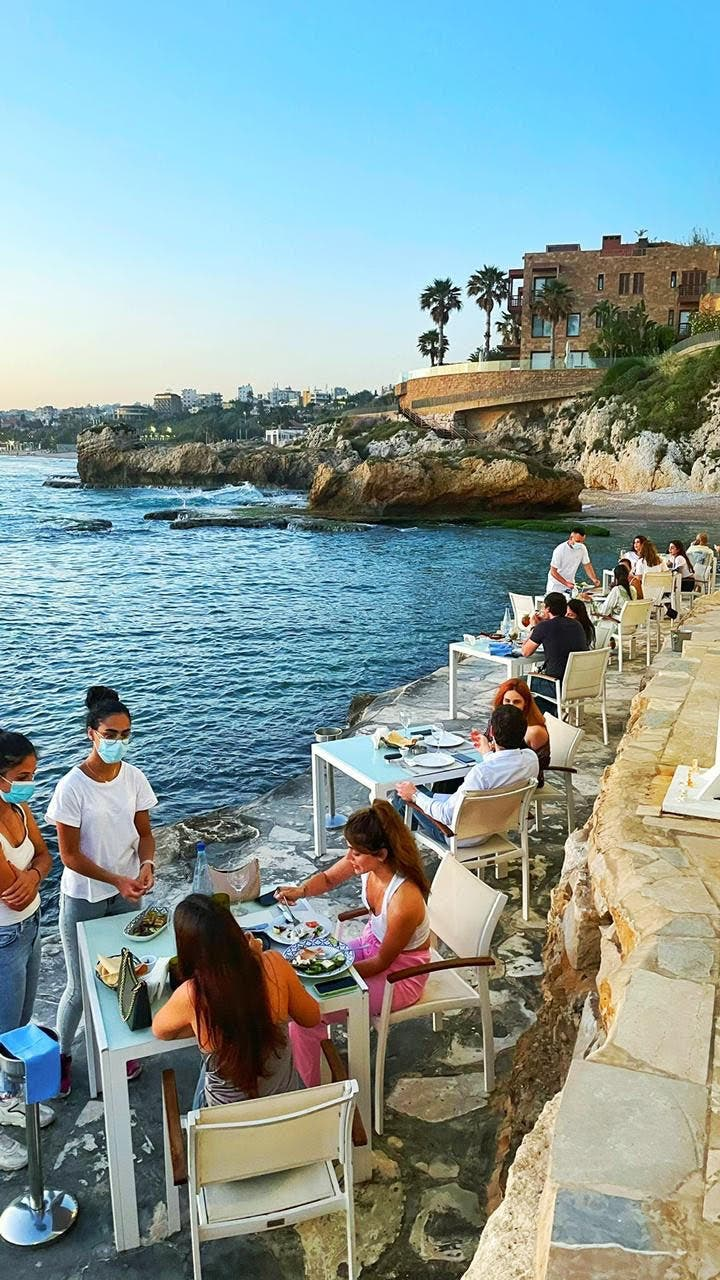 Lunch by the sea in Byblos, Lebanon on June 12, 2021.