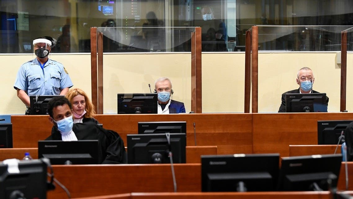 """Former head of Serbia's state security service Jovica Stanisic and his subordinate Franko """"Frenki"""" Simatovic appear in court at the UN International Residual Mechanism for Criminal Tribunals (IRMCT) in The Hague, Netherlands June 30, 2021. (Reuters/Piroschka van de Wouw/Pool)"""